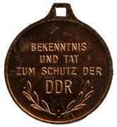 Medal - Bekenntnis und Tat zum Schutz der DDR – reverse