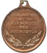 Medal - Bekenntnis und Tat zum Schutz des Sozialismus – reverse