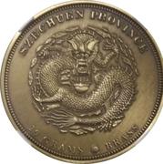 29g Brass (1 oz Silver Charles Barber's Dragon Pattern) – obverse
