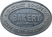 ½ Loaf Bakery Token - Newcastle & District Co-operative Limited – obverse