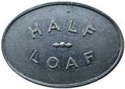 ½ Loaf Bakery Token - Newcastle & District Co-operative Limited – reverse