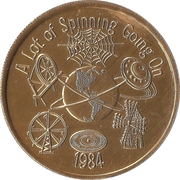 Mardi Gras Token - Krewe of Mid-City (A Lot of Spinning Going On; golden; New Orleans, Louisiana) – obverse